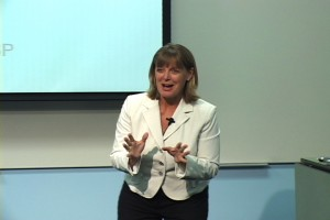 Cyndi speaking at a conference.